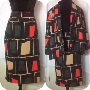 Skirt suit.  designed in black, beige and coral.